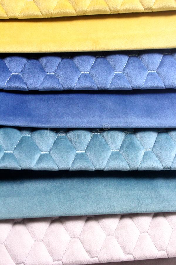 Colorful patterns of upholstery fabric. Close-up of samples of furniture fabric. Multicolored soft velour. Furniture industry. Bac. Kground texture. Fabric royalty free stock photos