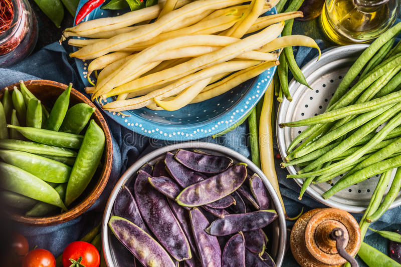 Colorful pea and bean pods in bowls, top view, close up. Healthy vegetarian food royalty free stock photo