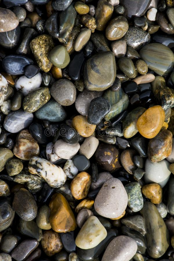 Colorful pebbles on the beach stock photo