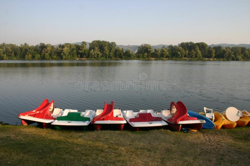 Colorful pedal boats on Silver Lake in Serbia stock image