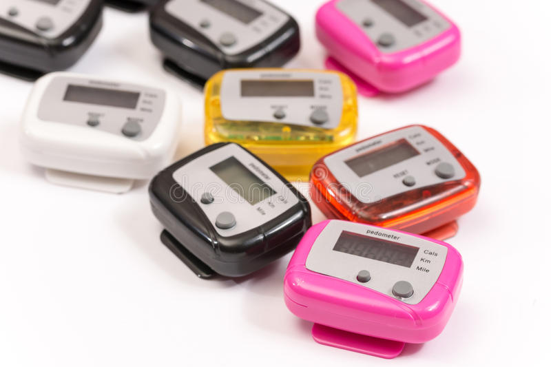 Colorful pedometers over white background royalty free stock images