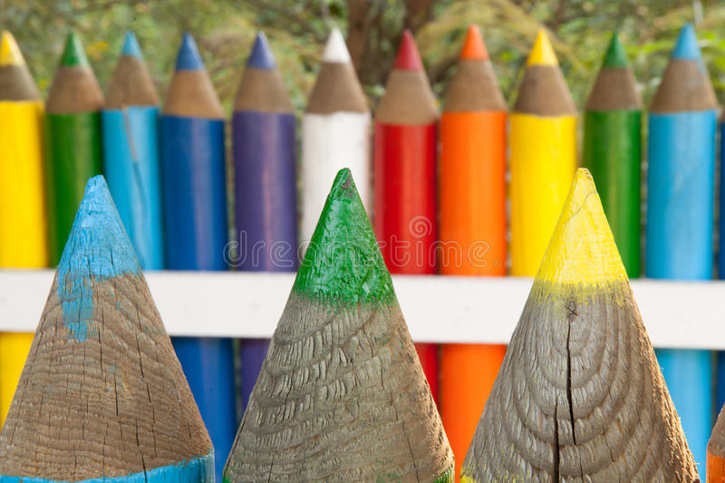 Colorful pencil fence. Photo of colorful pencil fence