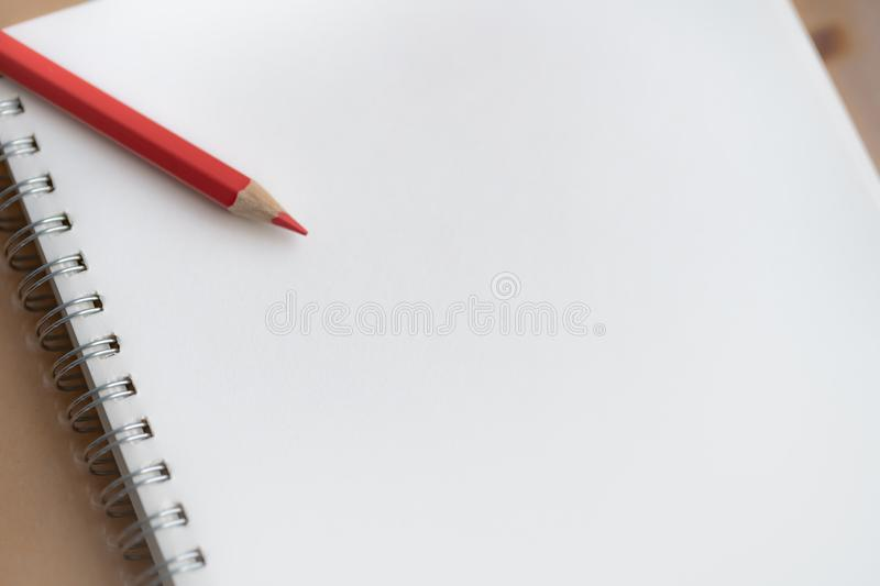 Colorful pencil on notebook. stock image