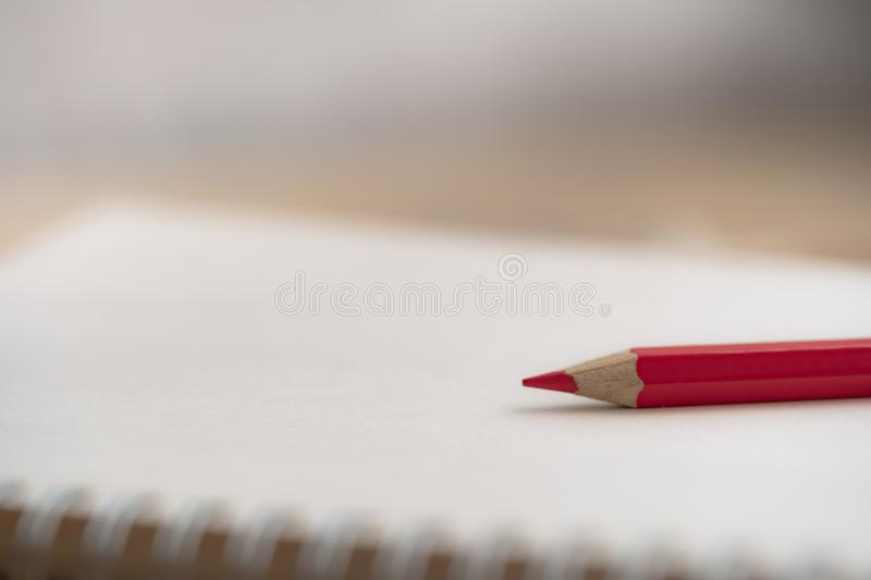 Colorful pencil on notebook. stock photos