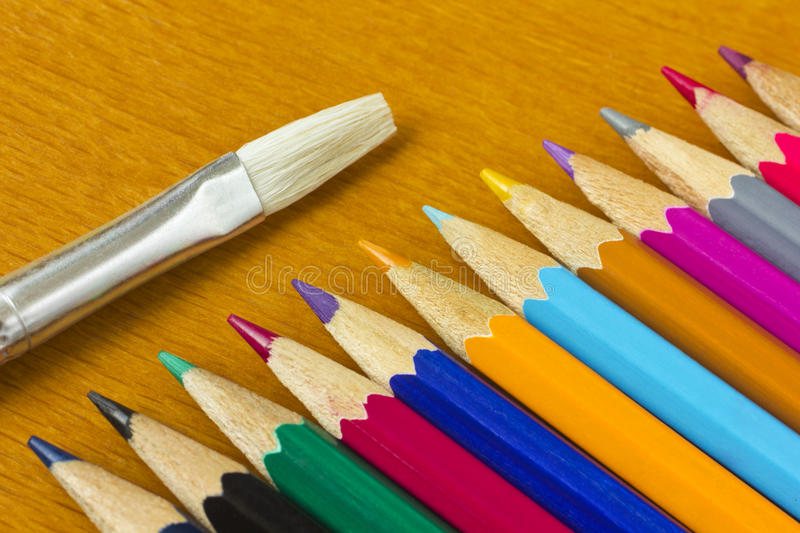 Colorful pencils and brush royalty free stock photo