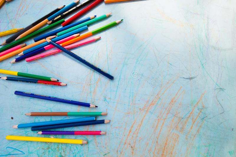 Colorful pencils on a children's table for drawing. Pensils on left side stock photography