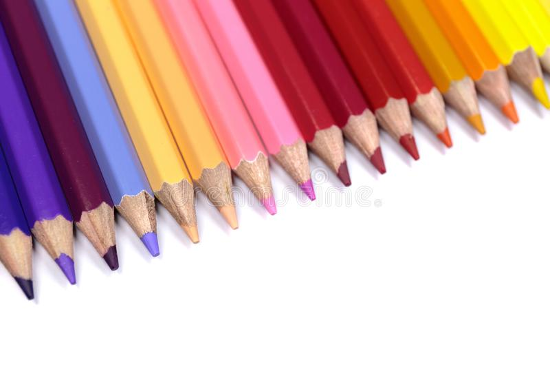 Colorful Pencils Close Up Facing Down from Top Left Corner royalty free stock photos