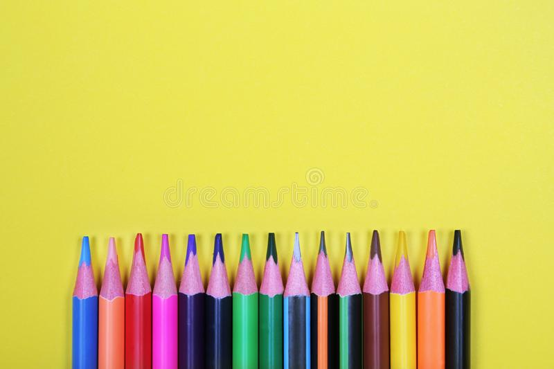 Colorful pencils with copy space on yellow background,education back to school, sale, shopping concept. stock photos