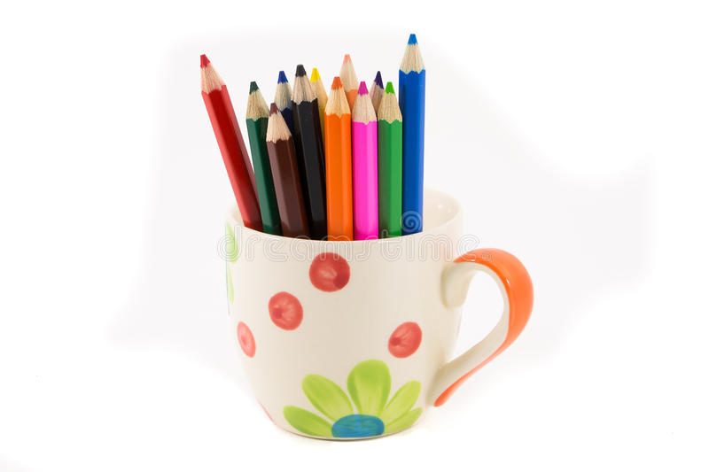 Colorful pencils in pail isolated on white stock photo