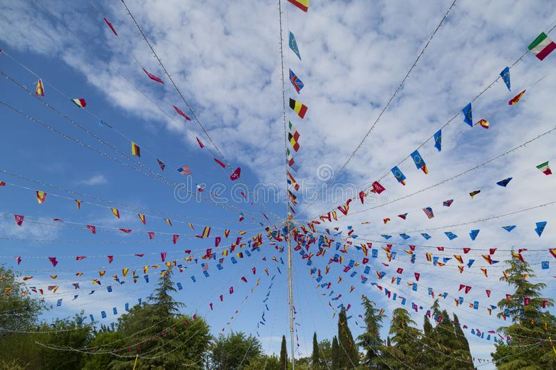 Colorful pennants flags hanging over blue sky. Festival or party concept royalty free stock image