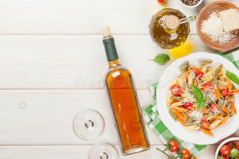 Colorful penne pasta and white wine stock images