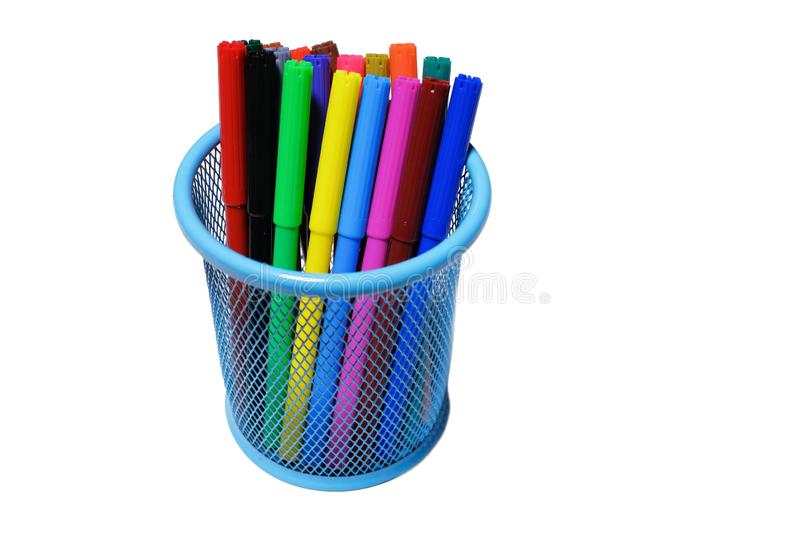 Colorful pens and markers in a glass isolated on a white background. The concept of school and pre-school education. Children`s. Creativity stock photography