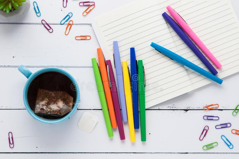 Desktop flatlay with colorful office supplies royalty free stock images