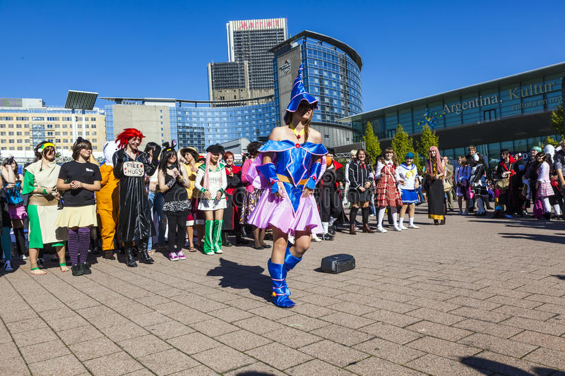 Colorful people made up as Manga from the Comic scene with costumes have a big party stock photos