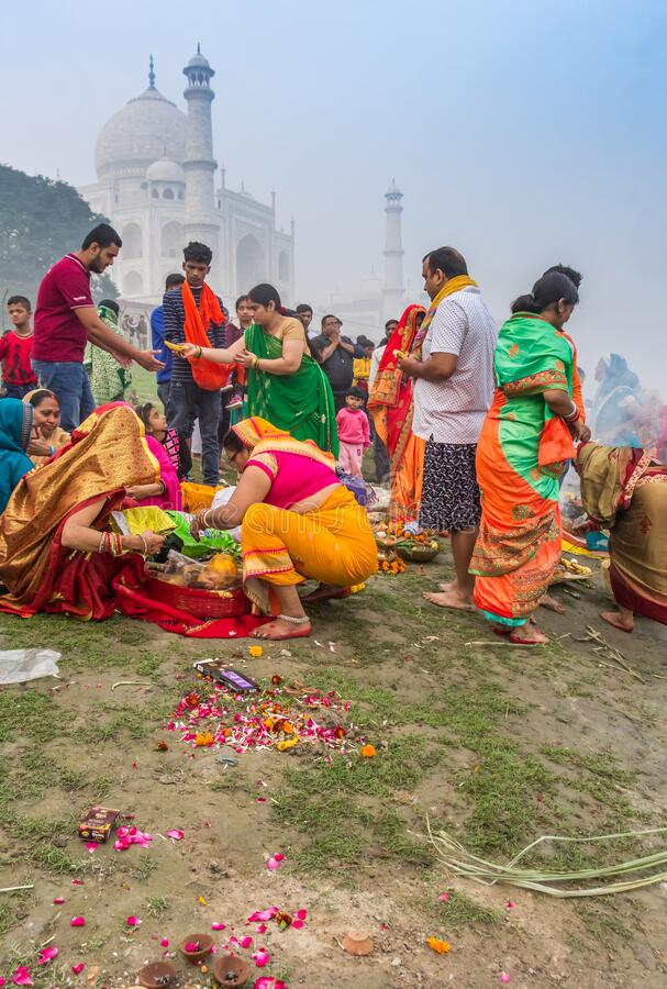 Colorful people at the river behind the Taj Mahal in Agra royalty free stock photography