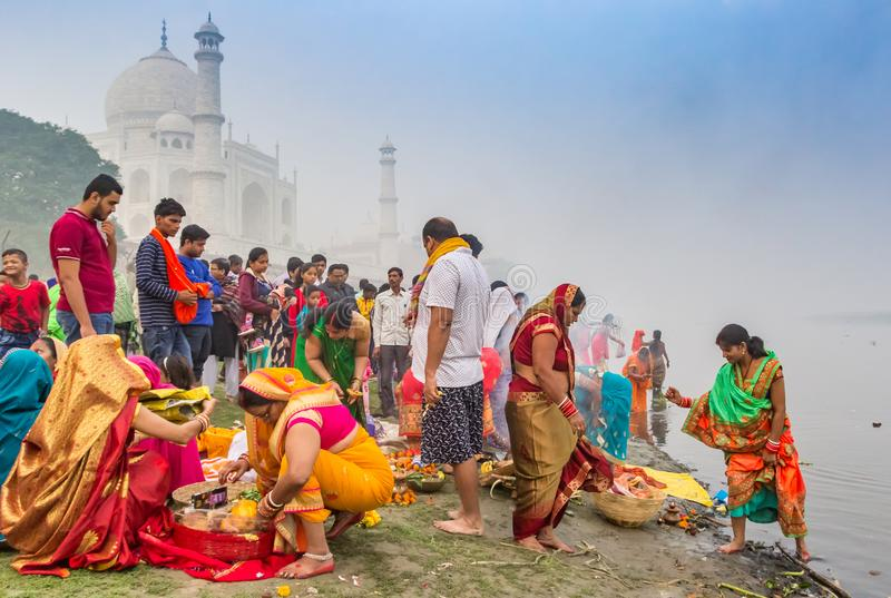 Colorful people at the river behind the Taj Mahal in Agra royalty free stock photos