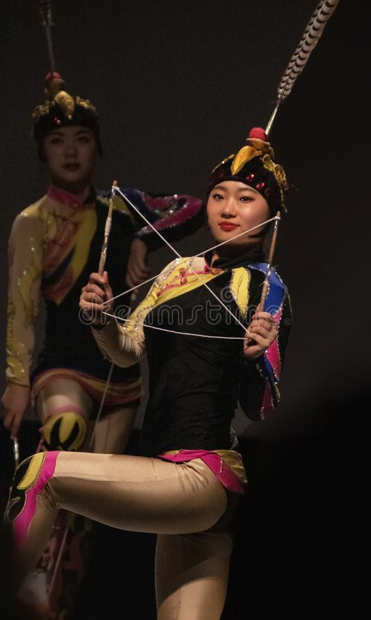 Colorful Chinese Troupe Performer at Florida State Fair in Tampa. A colorful performer from the Zaji Amazing Acrobats of China entertains at the Florida State stock photos