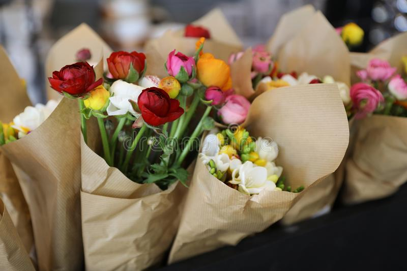 Colorful persian buttercup flowers or Ranunculus asiaticus bouquet in the flowers shop. stock image