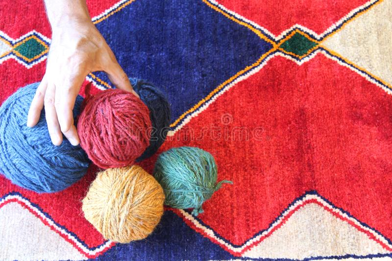 Colorful Persian handmade Carpet. With materials stock photo