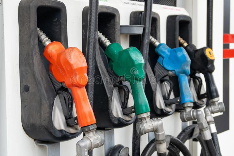 Colorful Petrol pump filling nozzles, Gas station in a service stock image