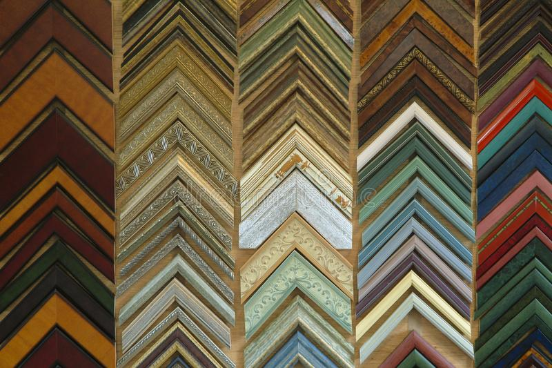 Colorful Picture Frame Samples Hanging on a Wall. royalty free stock image