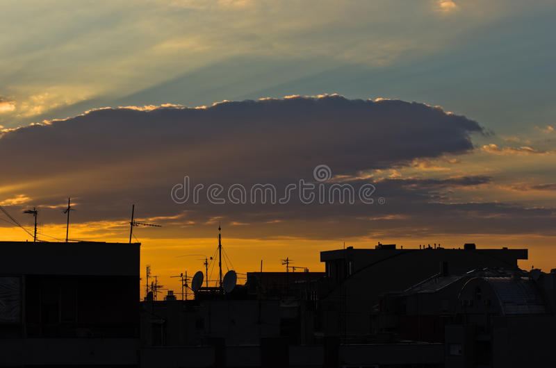 Colorful and picturesque clouds over city roofs at sunset in Belgrade royalty free stock images