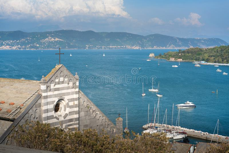 Colorful picturesque harbour of Porto Venere with San Lorenzo church, Doria Castle and Gothic Church of St. Peter, Italian Riviera royalty free stock photos