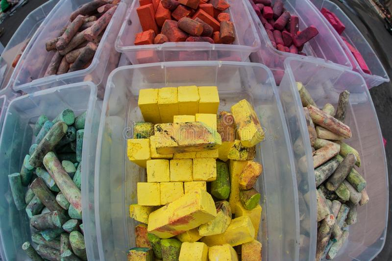 Colorful Pieces Of Chalk Sit In Plastic Containers. At chalk art contest stock images