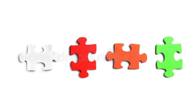 Colorful pieces of puzzle on white background stock image