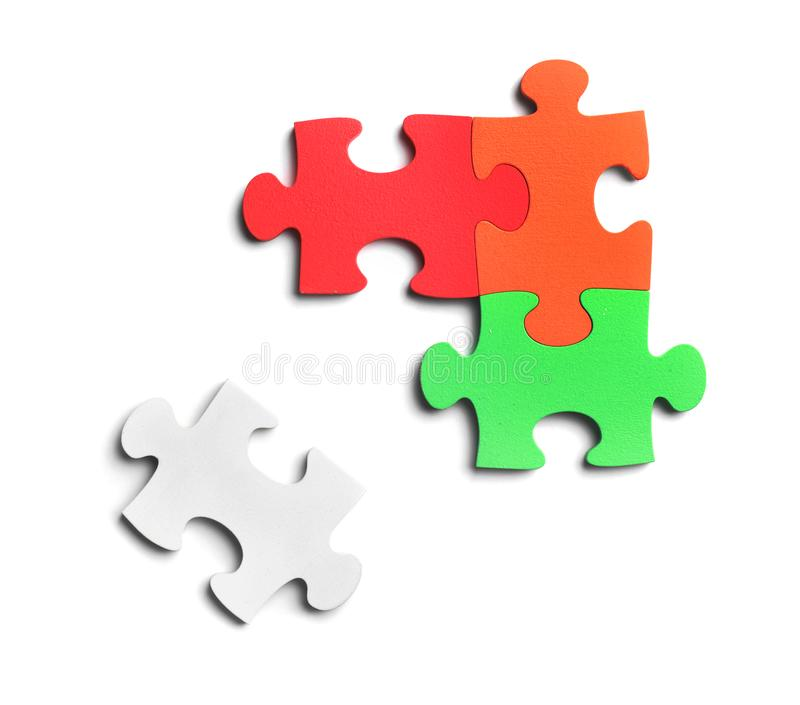 Colorful pieces of puzzle on white background stock images