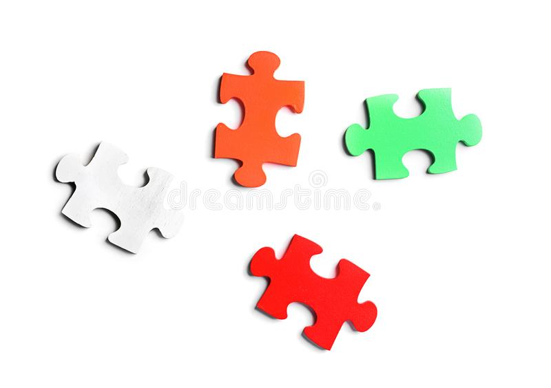 Colorful pieces of puzzle on white background stock photos