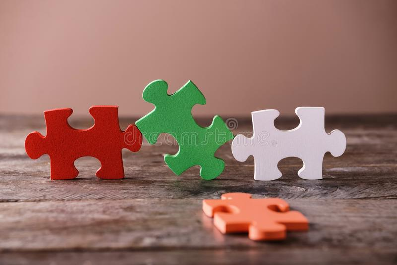 Colorful pieces of puzzle on wooden table royalty free stock image