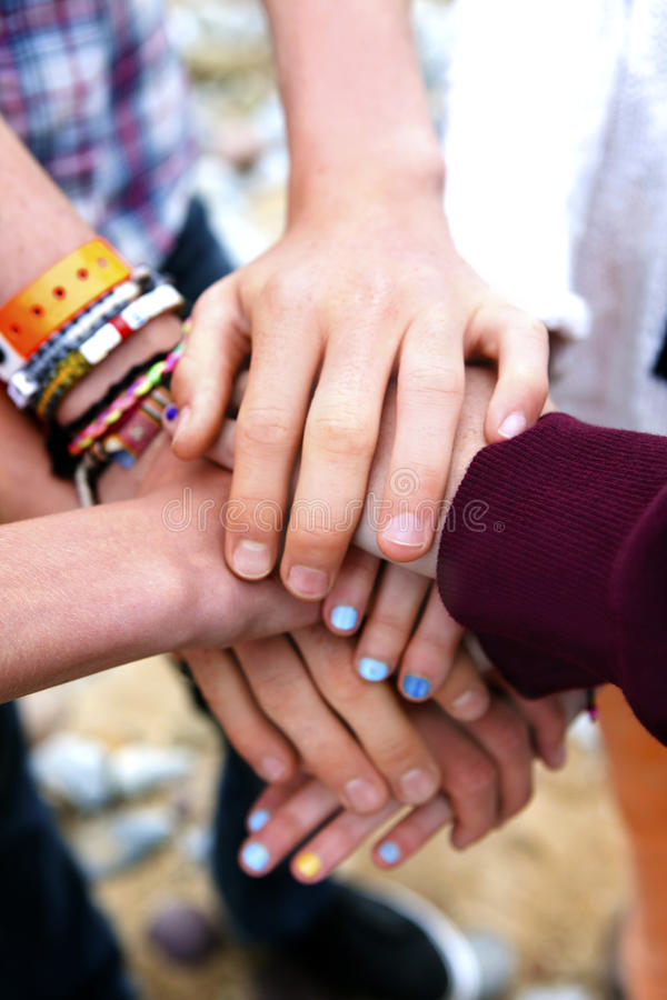 Colorful Pile of youngsters hands stock photos
