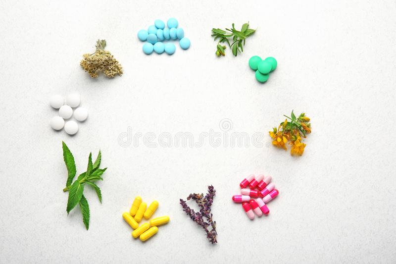 Colorful pills and herbs in shape of circle royalty free stock photography