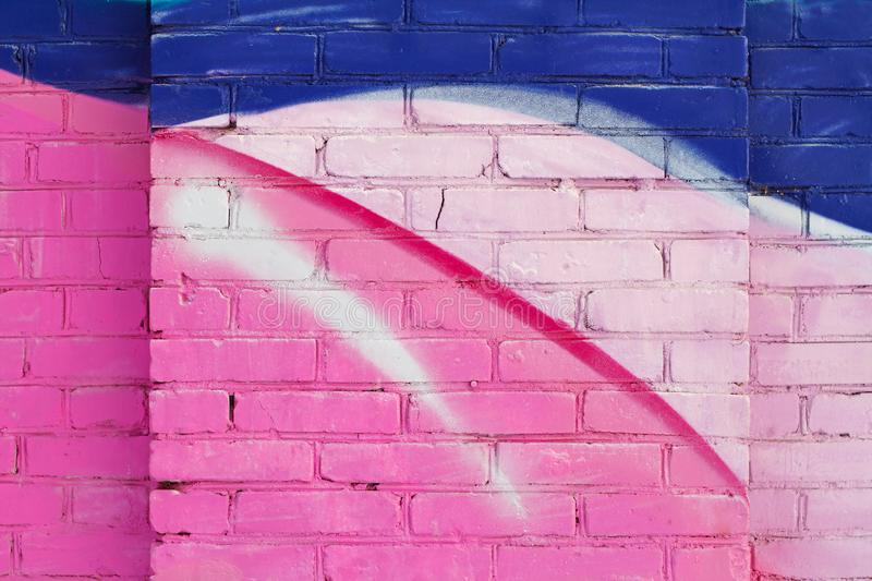 Colorful pink, blue and white painted brick wall royalty free stock images