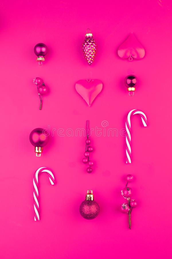 Colorful pink Christmas composition with decorations on vivid pink background royalty free stock image