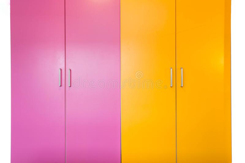 Colorful pink and orange freshly painted wall and closet doors, doors are closed isolated on white stock images