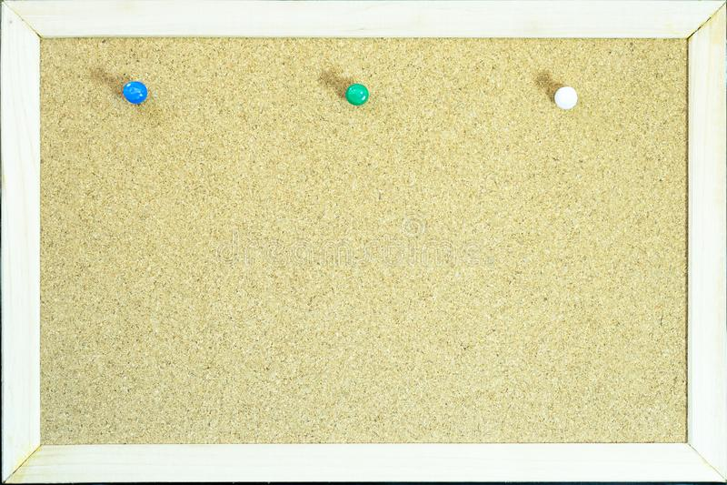 Colorful pins on cork board for memo or education stock photography