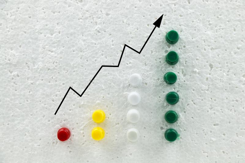 Colorful pins on polystyrene business growth chart. Colorful pins on polystyrene business growth chart stock image