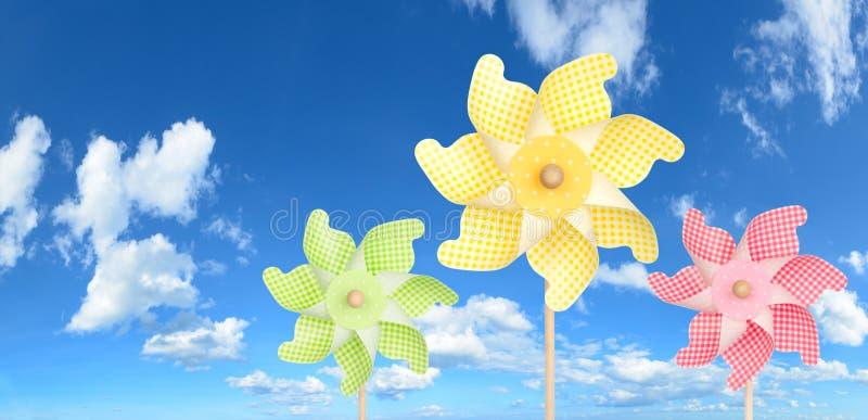 Colorful pinwheels over panorama blue sky stock photo