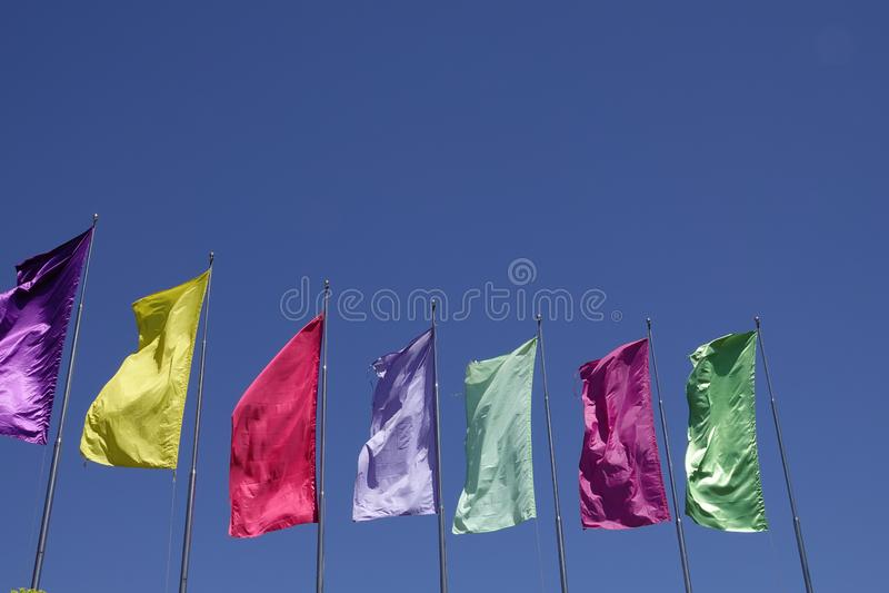 Colorful plain flag on blue sky background stock photo