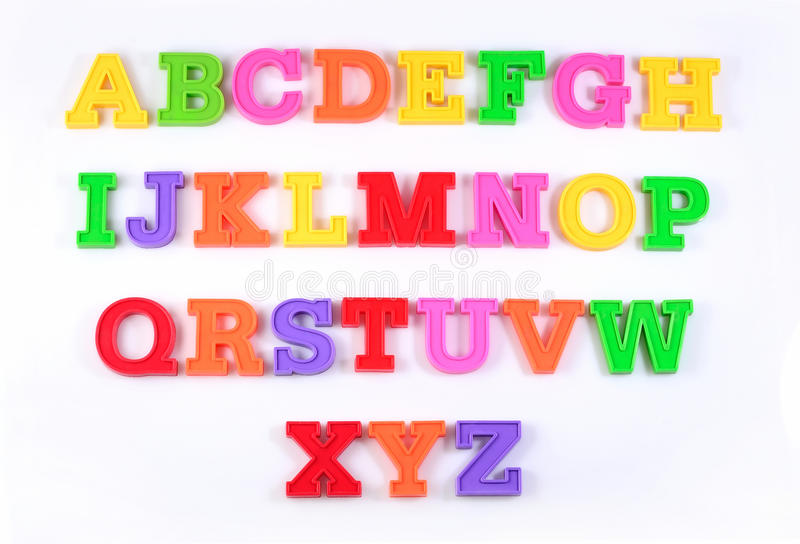 Colorful plastic alphabet letters on a white. Background stock photography