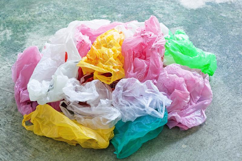 Colorful plastic bag on cement background stock photo