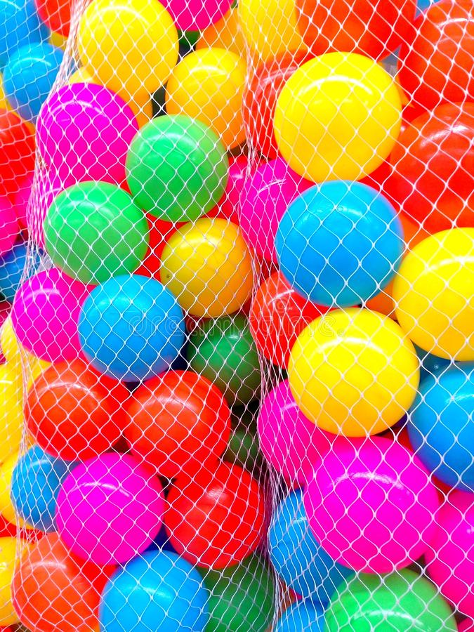 Colorful plastic ball toys. Photo of colorful plastic ball toys royalty free stock photo
