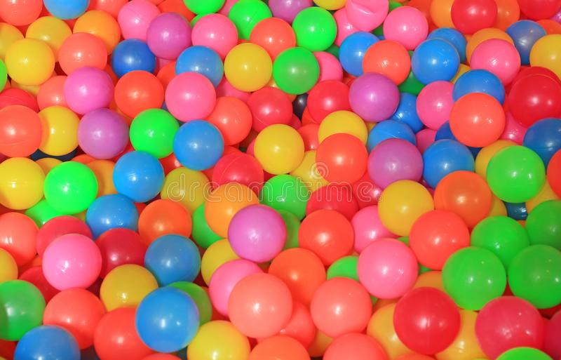 Colorful plastic balls on children`s playground stock photos