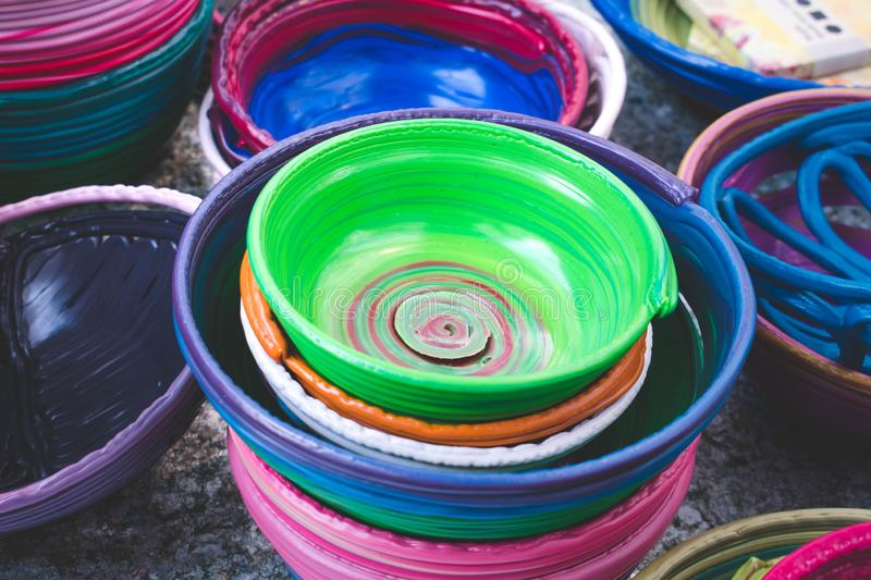 Colorful of polyethylene baskets stock images