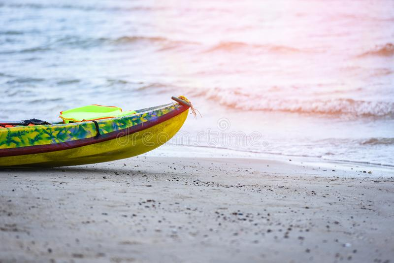 Colorful plastic boat on sandy beach sea stock photo