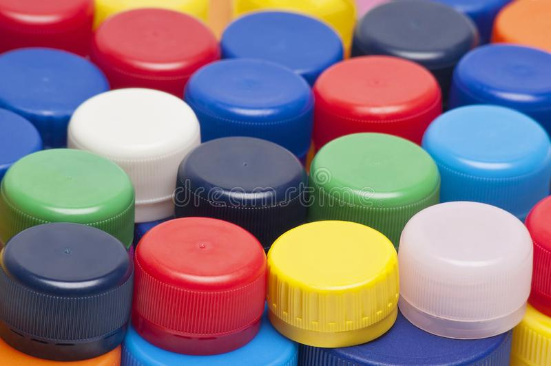 colorful plastic bottle cups as background stock images