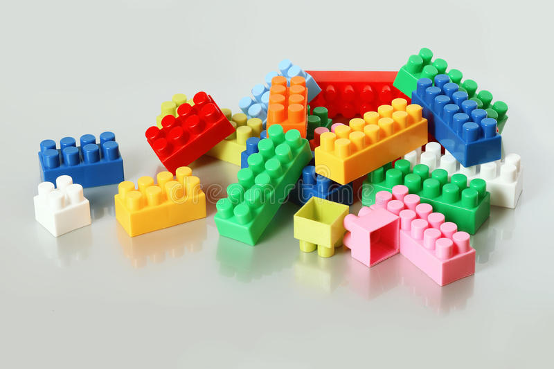 Colorful plastic building blocks. Interesting and educational toys for children. Colorful plastic building blocks royalty free stock image