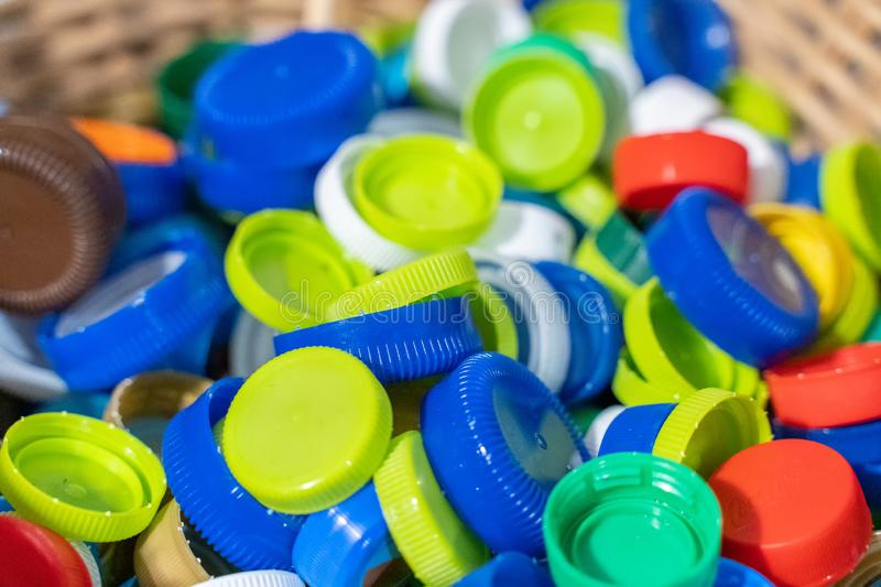 Colorful plastic caps ready for recycling. Reduce plastic waste in environment royalty free stock photography